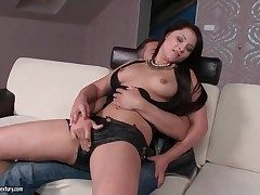 Chick in sexy leather shorts gives a lap dance