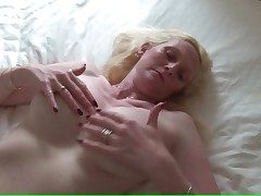 Big boobed mature pulls on her nipples