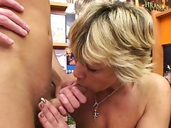Magnificent blonde mature fucks him in the video store