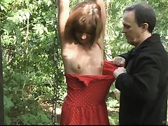 Teenager slave trussed spanked and ravaged in the forest