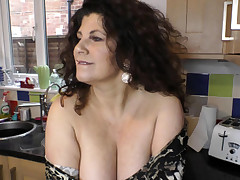 Sexy busty honey dancing and demonstrating downblouse